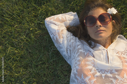 High angle view of woman sleeping in grass