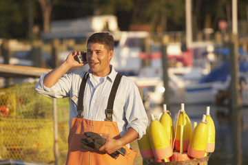 Hispanic fisherman talking on cell phone