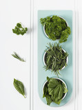 High angle view of cut herbs in jars