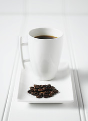 Coffee and coffee beans on plate
