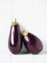 Close up of eggplants leaning against wall