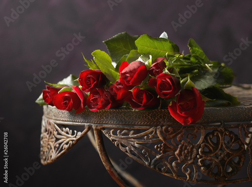 Bunch of roses on iron table