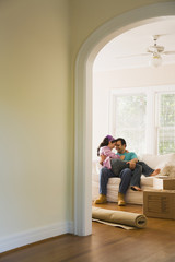 Hispanic couple hugging in new home