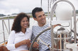 Hispanic couple drinking champagne on sailboat