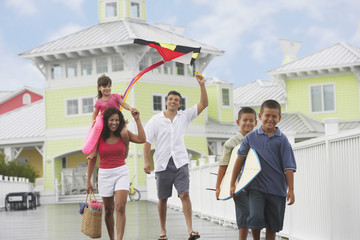 Hispanic family walking on boardwalk