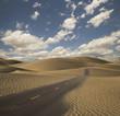 Paved road through desert