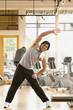 Pacific Islander man stretching in health club