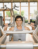 Pacific Islander man exercising in health club