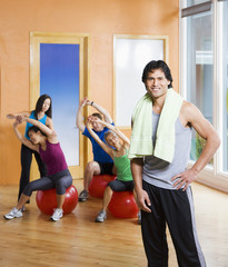 Man standing in front of exercise group