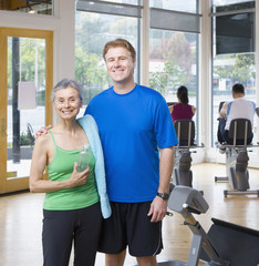 Man and woman standing together in health club