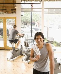 Pacific Islander man with towel in health club