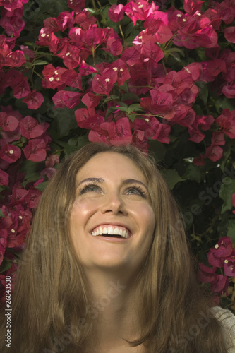 Close up of Hispanic woman looking up at flowers