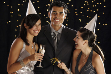 Hispanic friends drinking champagne on New Year's Eve