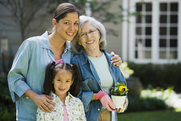 Group of female hispanic family members standing outdoors