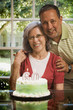 Hispanic woman celebrating birthday with husband
