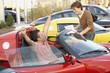 Hispanic couple buying luxury car