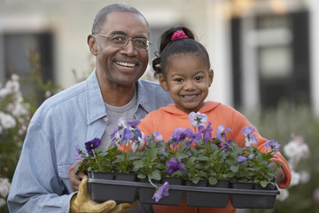 African grandfather and granddaughter gardening