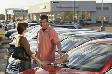 Hispanic couple car shopping