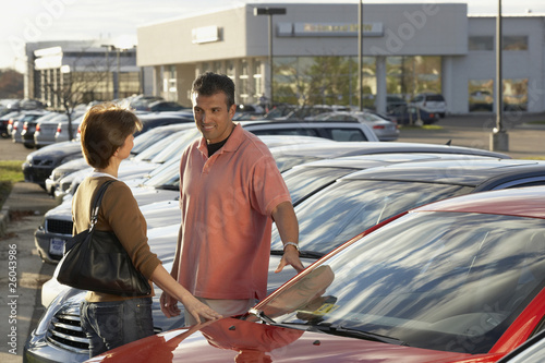 Hispanic couple car shopping