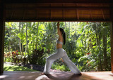 Pacific Islander woman performing yoga in jungle