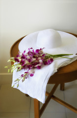 Sun hat and flowers on table