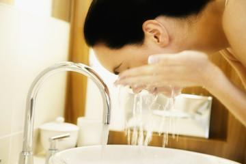 Pacific Islander woman washing face