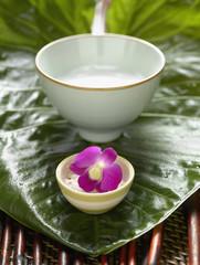 Bowls of bath salts on leaf