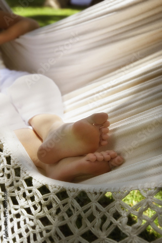 Close up of woman's feet in hammock