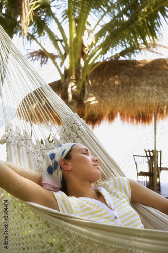 Pacific Islander woman sleeping in hammock