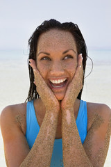 Pacific Islander woman covered in sand