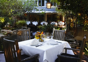 Outdoor restaurant table set for two