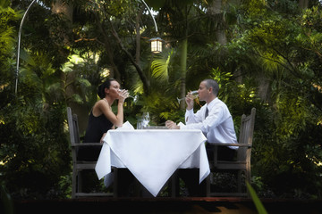 Couple eating at outdoor restaurant