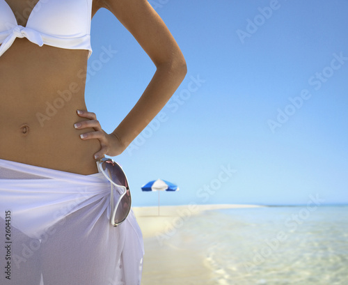Woman with hand on hip at beach