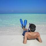 Man wearing snorkeling gear at beach