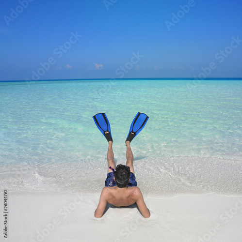Man wearing snorkeling gear at beach