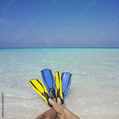 Couple wearing flippers at beach