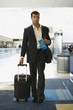 Hispanic businessman in airport