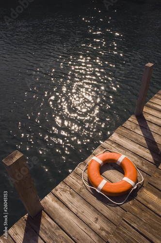 Round life preserver on wooden dock