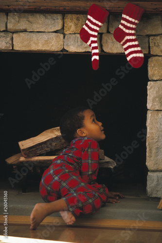 Young African boy looking up chimney