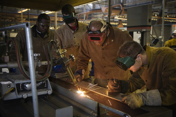 Welders working with torch