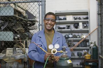 Mixed race refrigeration technician working