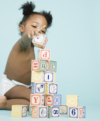 African American girl stacking wooden blocks
