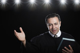 Hispanic man holding Bible and gesturing