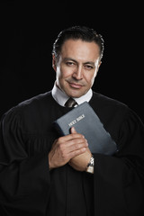 Hispanic preacher posing with Bible