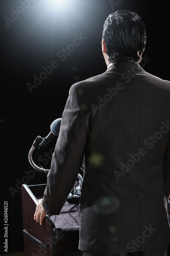 Hispanic man standing at podium