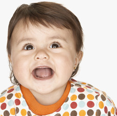 Close up of laughing hispanic baby girl