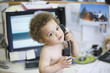 Mixed race boy talking on telephone