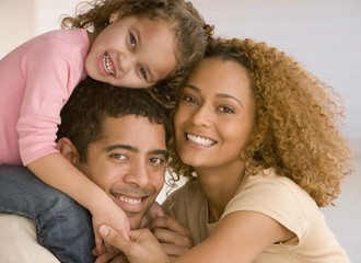 Smiling mixed race family portrait
