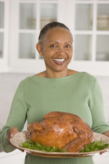 African woman holding Thanksgiving turkey