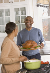 African couple preparing Thanksgiving dinner
